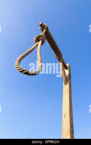 Gallows against blue sky - Stock Photo