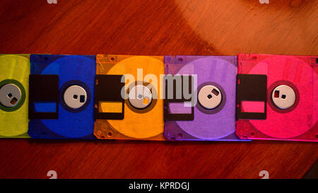 Colorful floppy disks in a line - Stock Photo