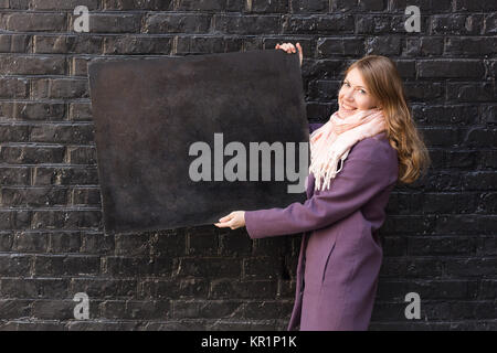 arts and crafts, creativity, advertisment concept. adorable woman wearing autumn clothes, she is smiling and holding - Stock Photo