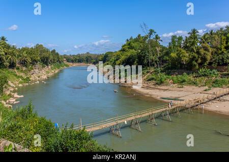 Wooden bridge over Nam khan rive in Luang Prabang, Laos - Stock Photo
