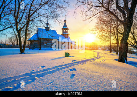 Russian church in winter forest - Stock Photo