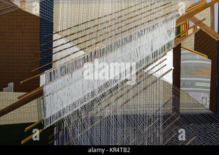 Traditional Thai silk hand weaving process - Stock Photo