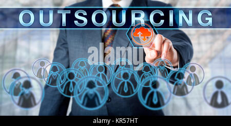 Business Manager Pushing OUTSOURCING - Stock Photo