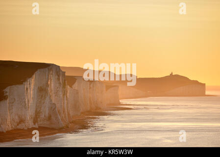 Cuckmere Haven, East Sussex. 18th December 2017. The morning sun illuminating the iconic Seven Sisters chalk cliffs - Stock Photo