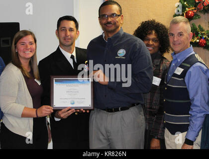 PENSACOLA, Fla. (Dec. 7, 2017)-Naval Air Station (NAS) Pensacola Executive Officer, Cmdr. Shawn Dominguez, is presented - Stock Photo
