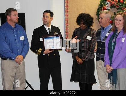 PENSACOLA, Fla. (Dec. 7, 2017)-Naval Air Station (NAS) Pensacola Executive Officer, Cmdr. Shawn Dominguez, addresses - Stock Photo