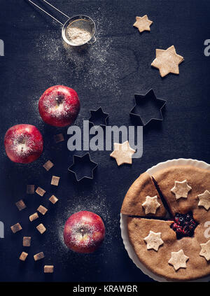 Vegan homemade pie from currant and apples on black background - Stock Photo