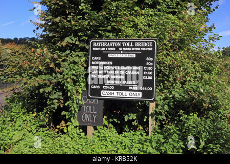 Sign showing charges for use of Batheaston Toll Bridge over River Avon - Stock Photo