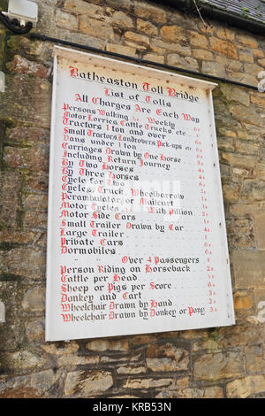 Sign showing old charges for use of Batheaston Toll Bridge over River Avon - Stock Photo
