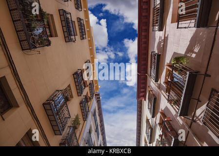 Residential buildings on a narrow street in Madrid, Spain. - Stock Photo