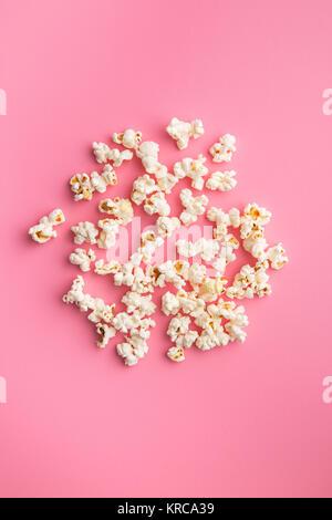 popcorn on pink background - Stock Photo