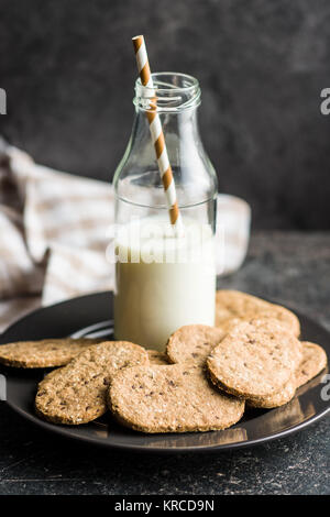 Tasty oatmeal cookies and milk. - Stock Photo