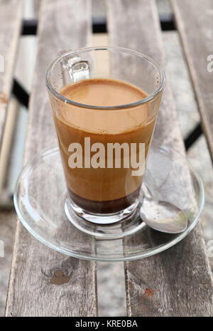 Turkish coffee with milk in glass cup close up - Stock Photo