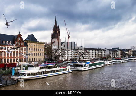 Frankfurt, Germany. River Main view.Bernusbau building, Burnitsbau,spire of Cathedral,apartment buildings,boats - Stock Photo