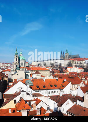 St. Nicolas church, Prague castle and and roofs of old town on a bright day, panoramic image, space for your text - Stock Photo