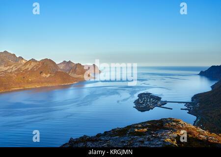 Island fishing village of Husoy in Oyfjorden, Senja, Lenvik, Troms, Norway - Stock Photo