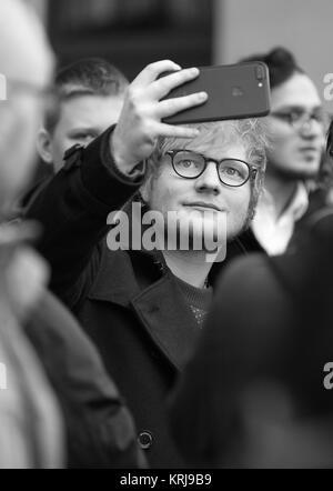 London, UK. 12th December, 2017. ( Image digitally altered to monochrome ) Ed Sheeran seen seen at the BBC Radio - Stock Photo