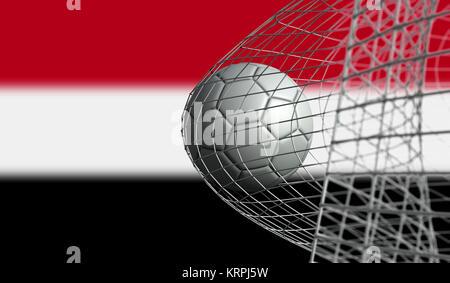 Soccer ball scores a goal in a net against Yemen flag. 3D Rendering - Stock Photo