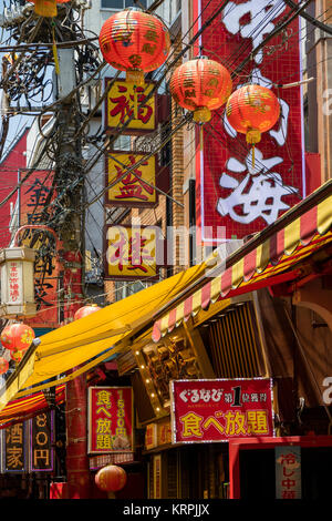 Yokohama - Japan, June 16, 2017; Traditional red decorated facades in China town, Yokohama city - Stock Photo