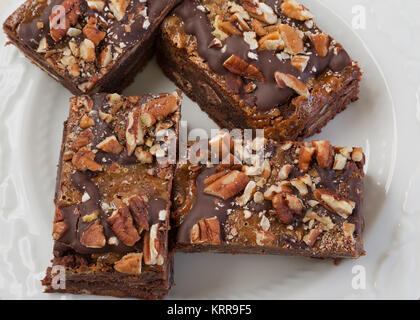 Chocolate brownies with peacans and caramel. - Stock Photo