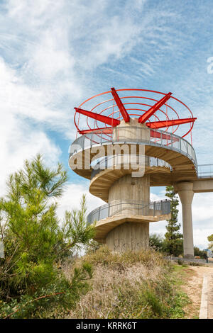 Beautiful observation deck with a spiral staircase and red elements on a background of blue sky - Stock Photo