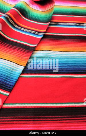 Mexico poncho serape Mexican traditional cinco de mayo rug fiesta background with stripes - Stock Photo