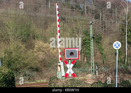 railway barriers at the level crossing - Stock Photo
