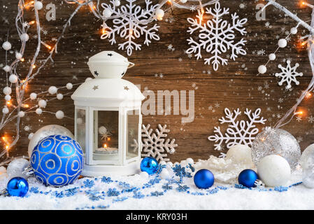 Christmas composition with lantern and Christmas lights on wooden background - Stock Photo