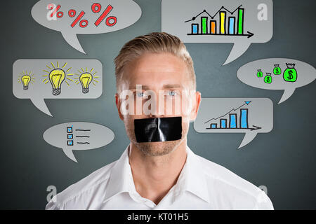 Businessman With Black Duct Tape On Mouth - Stock Photo