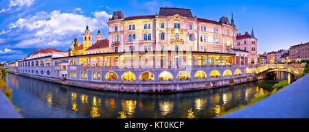 Ljubljana riverfront panorama evening view - Stock Photo