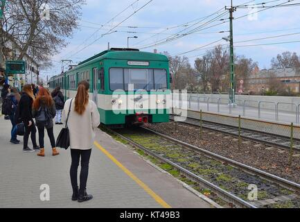In Obuda, northern part of Budapest (Hungary): People waiting for the HEV-Train to Budapest - Stock Photo