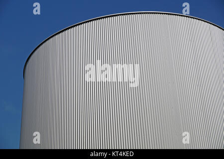storage silos against blue sky for beer processing - Stock Photo