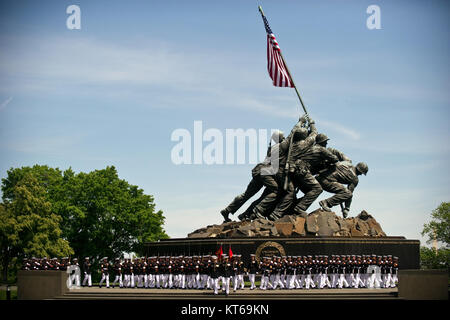 US Navy 110510-N-UH963-066 Marines march past the Marine Corps War Memorial during a Navy Cross medal award ceremony - Stock Photo