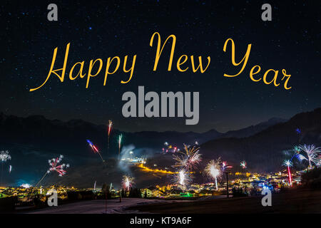 New Year's Eve fireworks in Fiss in Austria with the text Happy New Year above - Stock Photo