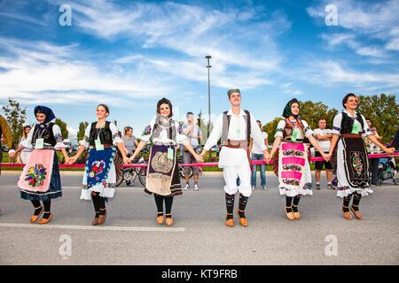 NOVI SAD, SERBIA-OCT 4, 2015: Guinness World Record Largest Folk Dance on Oct 4. 2015 in Novi Sad, Serbia. Over - Stock Photo