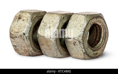 Three old rusty nuts in a row - Stock Photo