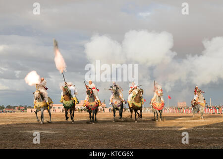 Tbourida equestrian festival with synchronized cavalry charges and musket firing - Stock Photo
