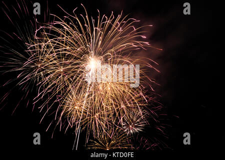 Firework blast in dark sky at night celebration new year,count down event,abstract lights explosion - Stock Photo