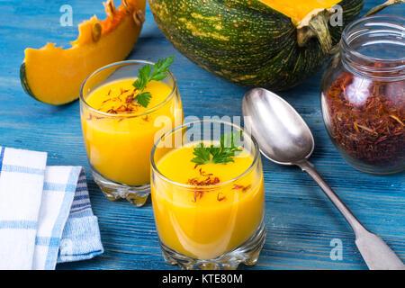 Cold pumpkin cream soup in glasses. Studio Photo - Stock Photo