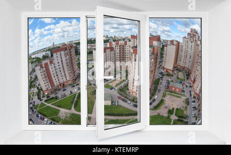 View through the pvc window frame on high floor at the residential court in dwelling district of city - Stock Photo