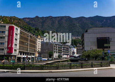 Andorra la Vella, Andorra Hotel and houses on Gran Valira river. Local buildings by a green hill on the Andorran - Stock Photo