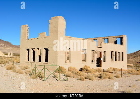 Ruined school building in Rhyolite ghost town near Beatty, Nevada, United States of America. - Stock Photo