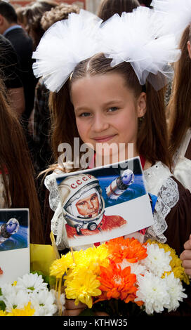 Russian schoool girl Linda, 10, from the Russian International Theatre School. A statue of Yuri Gagarin, the first - Stock Photo