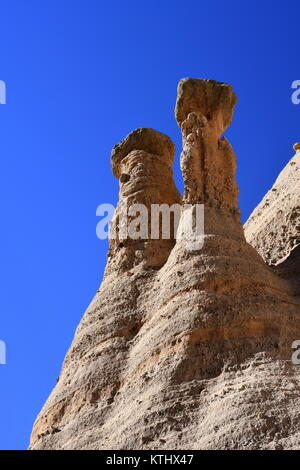 Closeup of two erosional cones in Tent Rocks National Monument illustrates the protective top cap to the elements - Stock Photo