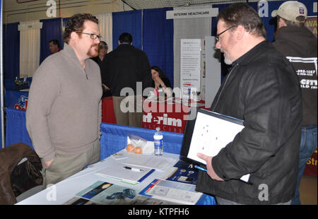 A job seeker speaks to a recruiter during a Hiring our Heroes job fair sponsored by the U.S. Chamber of Commerce - Stock Photo