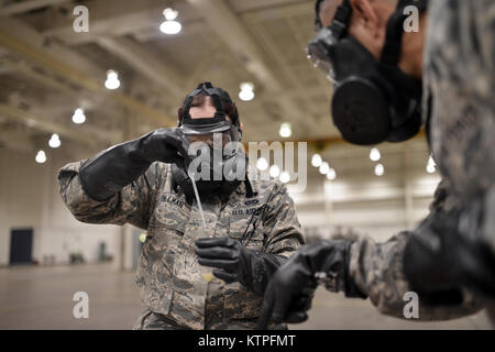 PERRY, GA - Airman First Class Reneee Dillman squeezes a sample of an unidentified substance into a container for - Stock Photo