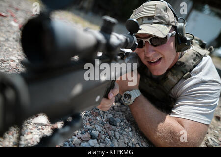 WESTHAMPTON BEACH, NY -  Senior Airman Christopher Reiter trains with a Barrett sniper rifle at the Suffolk County - Stock Photo