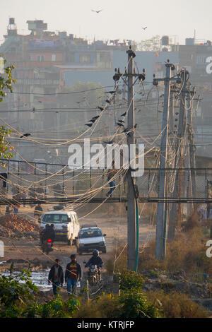 People and traffic in Kathmandu street scene, Nepal - Stock Photo