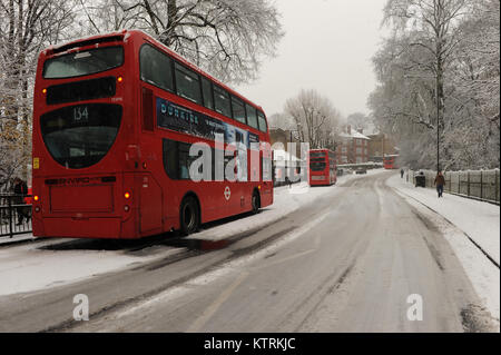 Buses are stranded due to heavy snowfall on Muswell Hill Road in London, England on December 10 2017 - Stock Photo