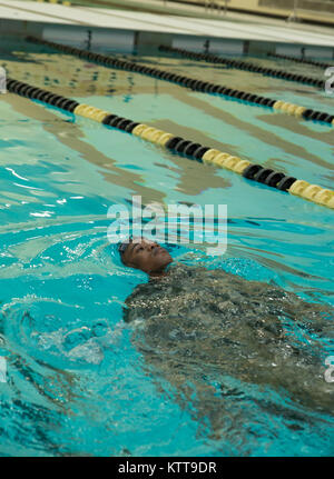 U.S. Army Pfc. Julius Forde swims the 100m swim event during the New York Army National Guard Best Warrior Competition - Stock Photo
